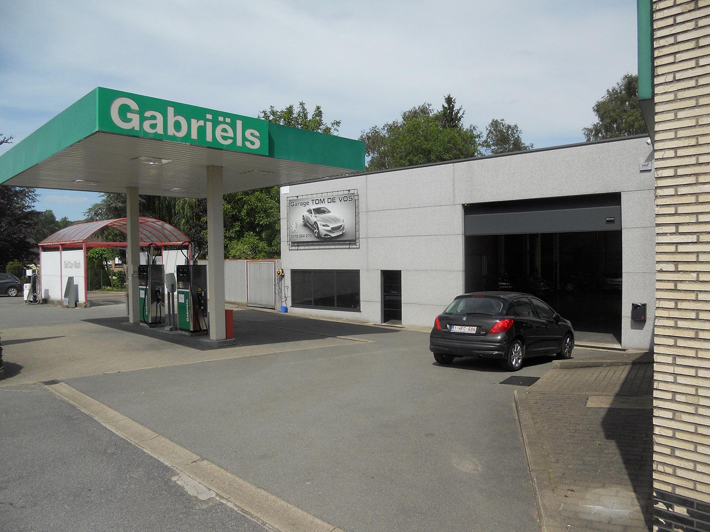 Garage tom de vos for Reprise 206 garage